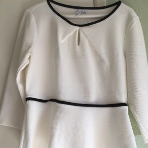 White flowy top from Elle with black trim.